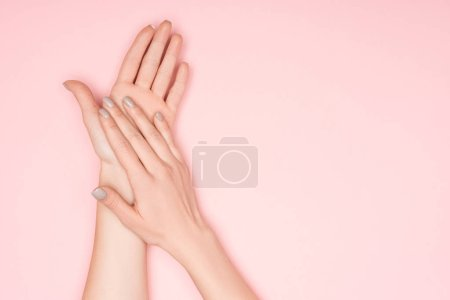 cropped view of female hands isolated on pink with copy space