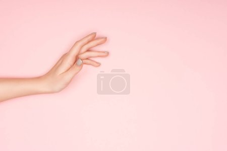 Photo for Partial view of female hand isolated on pink with copy space - Royalty Free Image