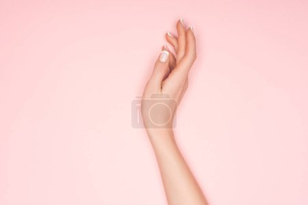 Photo for Top view of female hand isolated on pink with copy space - Royalty Free Image