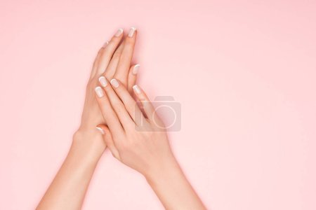 partial view of female hands isolated on pink with copy space