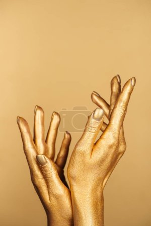 cropped view of female painted hands isolated on gold with copy space