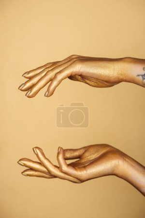 Photo for Partial view of female painted hands isolated on gold - Royalty Free Image