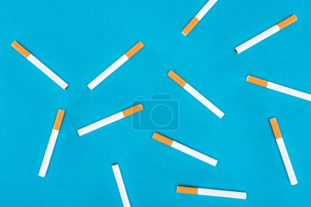 Photo for Flat lay of cigarettes isolated on blue - Royalty Free Image