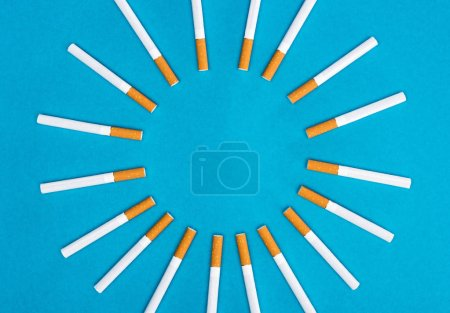 Photo for Flat lay with cigarettes isolated on blue - Royalty Free Image
