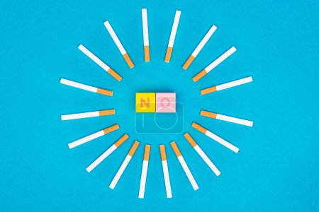 Photo for Flat lay with colorful letter cubes and cigarettes isolated on blue, stop smoking concept - Royalty Free Image
