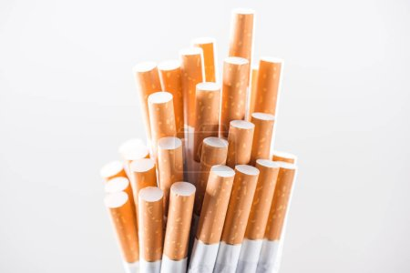 Photo for Studio shot of bunch of cigarettes isolated on white - Royalty Free Image