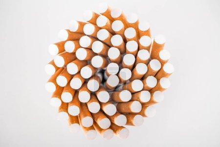 Photo for Flat lay with bunch of cigarettes isolated on grey - Royalty Free Image