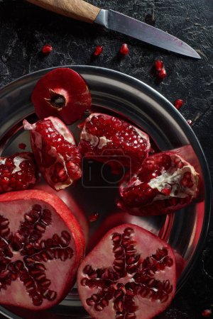 Photo for Top view of tasty pomegranates in metal bowl - Royalty Free Image