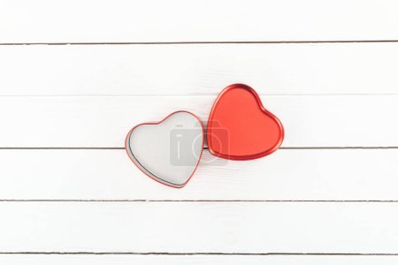 Photo for Top view of red heart shaped box on white wooden background, st valentines day concept - Royalty Free Image