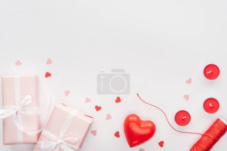 top view of gift boxes and valentines decorations isolated on white