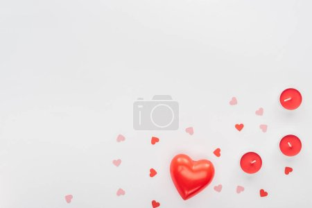 Photo for Top view of red candles and paper hearts isolated on white with copy space, st valentines day concept - Royalty Free Image