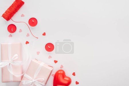 top view of gift boxes and valentines decorations isolated on white with copy space, st valentines day concept