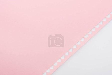 Photo for Background of cut out hearts in row on pink paper isolated on white - Royalty Free Image