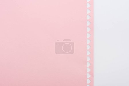 background of cut out hearts in row on pink paper isolated on white with copy space