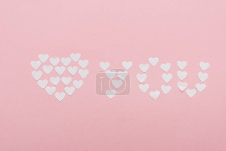 Photo for Top view of 'love you' made of paper hearts isolated on pink, st valentines day concept - Royalty Free Image