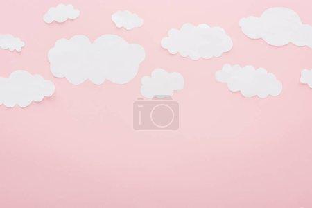 Foto de Vista superior de las nubes de papel blanco aislado en rosa con espacio de copia - Imagen libre de derechos