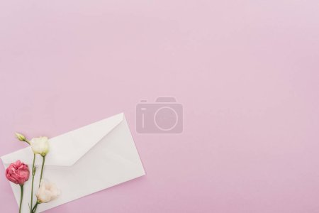 Photo for Top view of flowers and envelope isolated on pink with copy space - Royalty Free Image