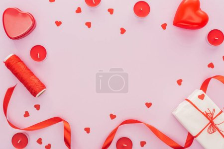 top view of paper hearts and valentine decorations isolated on pink with copy space, st valentines day concept