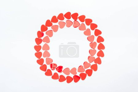 Photo for Top view of round frame made with red paper hearts isolated on white, st valentines day concept - Royalty Free Image
