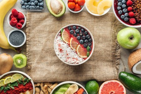Photo for Top view of smoothie bowls and frame made of fresh ingredients on sackcloth - Royalty Free Image