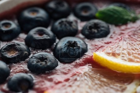Photo for Close up of blueberries and sliced lemons in smoothie bowl - Royalty Free Image