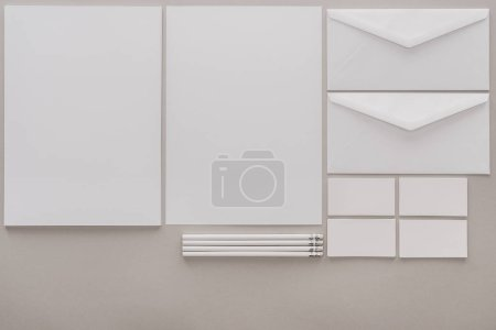 Photo for Flat lay with white empty papers and envelopes on grey background - Royalty Free Image