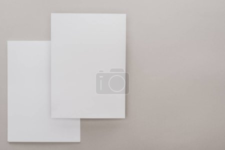 Photo for Top view of white empty papers on grey background - Royalty Free Image