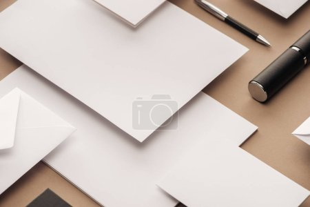 Photo for Case, envelope, sheets of paper and pen on beige background - Royalty Free Image