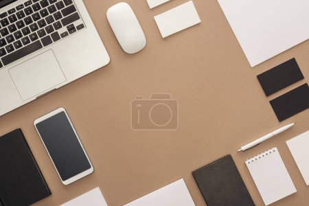 Photo for Laptop, smartphone, pen, computer mouse, cards and notebooks on beige background - Royalty Free Image