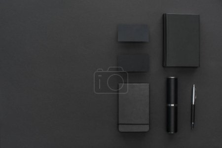 Photo for Notebooks, case, cards and pen on black background - Royalty Free Image