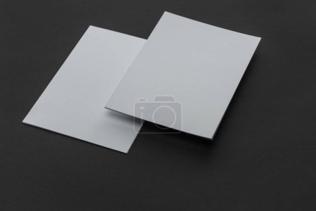 Photo for Empty sheets of paper with copy space on black background - Royalty Free Image