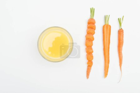 Photo for Top view of bowl of fresh carrot juice, sliced carrot, cut and whole carrots isolated on white - Royalty Free Image