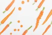 """Постер, картина, фотообои """"вид сверху морковь ломтиками, целом и вырежьте морковь, изолированные на белом"""""""
