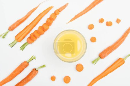 Photo for Top view of bowl of carrot fresh juice, carrot slices, whole and cut carrots isoltated on white - Royalty Free Image