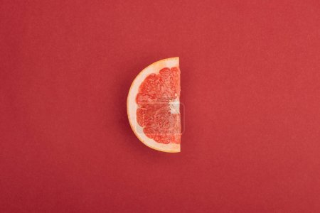 Photo for Top view of half slice of fresh ripe juicy grapefruit red background - Royalty Free Image