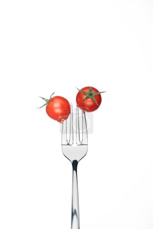 Photo for Fresh red whole cherry tomatoes on fork isolated on white - Royalty Free Image