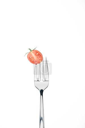 Photo for Half of fresh red cherry tomato on fork isolated on white - Royalty Free Image