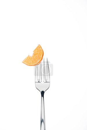 Photo for Slice of fresh ripe juicy tangerine on fork isolated on white - Royalty Free Image