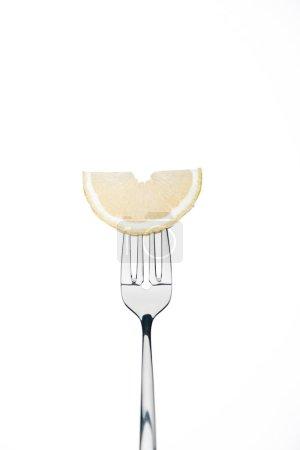 Photo for Half slice of fresh ripe juicy lemon on fork isolated on white - Royalty Free Image