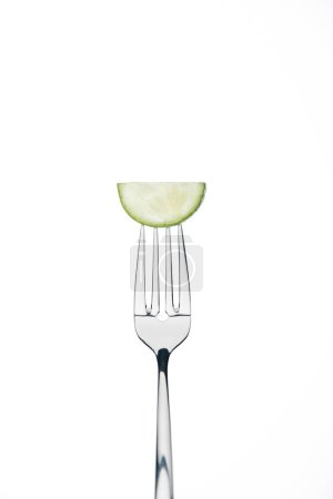 Photo for Half slice of fresh ripe cucumber on fork isolated on white - Royalty Free Image