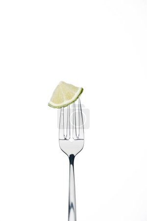 Photo for Quarter slice of fresh juicy lime on fork isolated on white isolated on white - Royalty Free Image