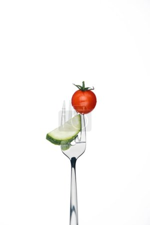 Photo for Whole red cherry tomato and slice of cucumber on fork isolated on white - Royalty Free Image