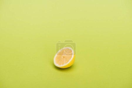 Photo for Half of fresh juicy lemon on green background - Royalty Free Image