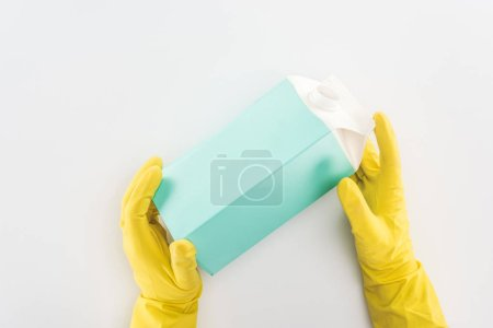 Photo for Cropped view of man in yellow rubber gloves holding empty carton bottle - Royalty Free Image