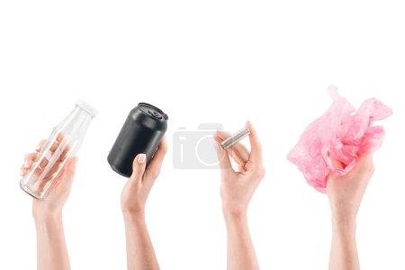 Photo pour Collage de mains féminines avec bouteille en verre, boîte noire, batterie et sac en plastique rose isolé sur blanc - image libre de droit