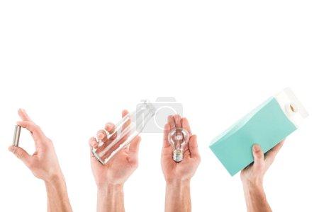 Photo pour Collage des mains masculines avec bouteille en verre, bouteille en carton, ampoule et sac en plastique rose isolé sur blanc - image libre de droit