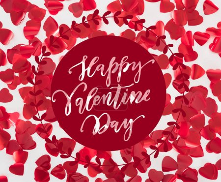 """Photo for Top view of beautiful red heart shaped petals on grey background with """"Happy valentines day"""" lettering - Royalty Free Image"""