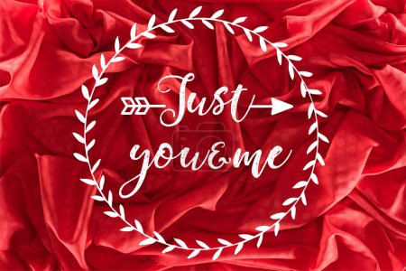 "Photo for Beautiful red silk fabric with ""just you and me"" lettering, valentines day background - Royalty Free Image"