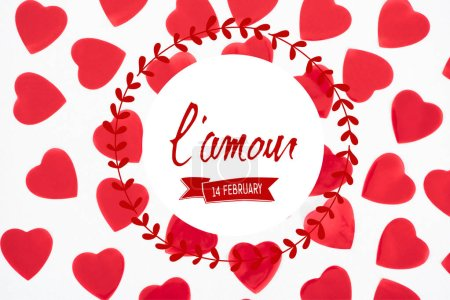 "Photo for Top view of beautiful decorative red hearts isolated on white background with ""lamour, 14 february"" lettering, valentines day concept - Royalty Free Image"