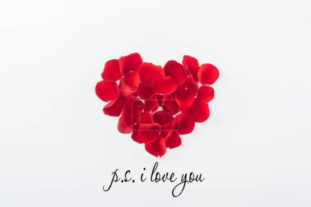 """Photo for Top view of heart made of red rose petals isolated on white, st valentines day concept with """"p.s. I love you"""" lettering - Royalty Free Image"""